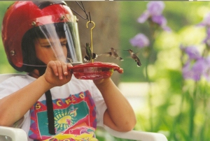 Toni Pulvermacher captured  this fun photo of her son, as his attention was captured by the hummingbirds.